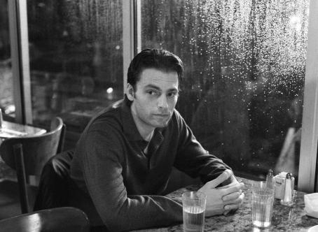 Flannel Pajamas Stuart (Justin Kirk) contemplates the tenuous relatioship he has with his brother in a scene romantic drama .