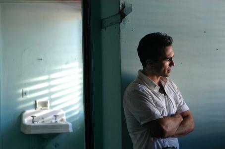 Nestor Carbonell Luis Fellove () contemplates his revolutionary actions just after leading an assault on the Presidential palace in Andy Garcia's film The Lost City.