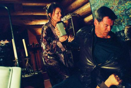 Claudette Mink  ('Judy,' left) and Pierce Brosnan ('Tom Ryan,' right) star in Lionsgate Home Entertainment's Butterfly on a Wheel.