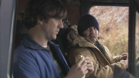 Aaron Stanford Lagrand (Paul Schneider) and Rugged () in van