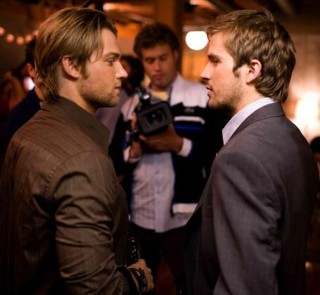 "Mike Vogel Jason (, left) attends a going-away party for his brother Rob (Michael Stahl-David, right) in ""Cloverfield."" Photo Credit: Sam Emerson. © 2008 by Paramount Pictures. All Rights Reserved."