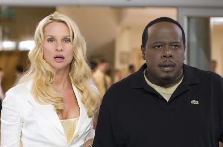 "Cedric the Entertainer Nicollette Sheridan as ""Diane"" and  as ""Jake"" in New Line Cinema's action comedy Code Name: The Cleaner. Photo Credit: 2005 Annabel Reyes/New Line Productions"