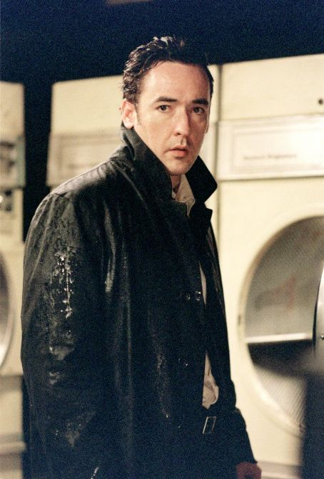 Identity - Ed (John Cusack), a cynical limo driver who is stranded at a roadside motel during a rain storm.