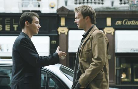 Chris Wilton (Jonathan Rhys Meyers) runs into his old tennis rival Henry (Rupert Penry-Jones) on the streets of London in MATCH POINT, distributed domestically by DreamWorks.
