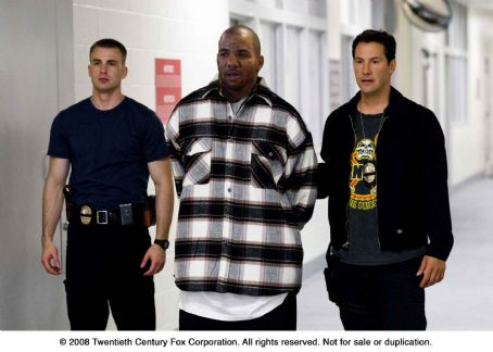 Game From left: Chris Evans, The  and Keanu Reeves in STREET KINGS.