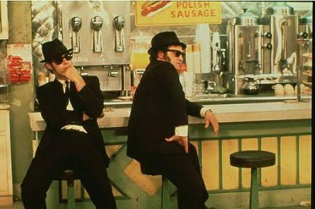 John Belushi Dan Aykroyd as Elwood Blues and  as 'Joliet' Jake Blues in John Landis's THE BLUES BROTHERS, Universal Pictures release. © 1980