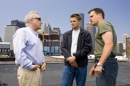 "Martin Scorsese Director MARTIN SCORSESE discusses a scene with actors LEONARDO DiCAPRIO and MATT DAMON on the Boston location set of Warner Bros. Pictures' crime drama ""The Departed."" Photo by Andrew Cooper"