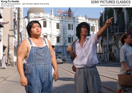 Stephen Chow Left: Lam Tse Chung as Bone; Right: Filmmaker,  as Xing.