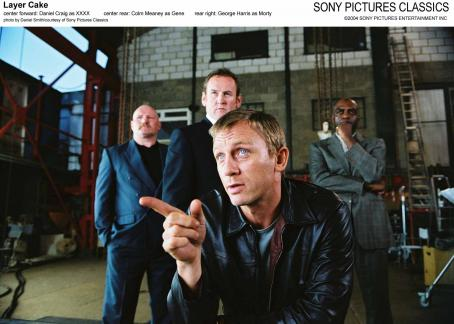 XXXX Center Forward: Daniel Craig as ; Center Rear: Colm Meaney as Gene; Rear Right: George Harris as Morty.