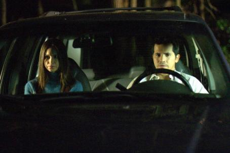 Katherine Waterston Shirley () and Michael (John Leguizamo) in Peace Arch Releasing 'The Babysitters.'