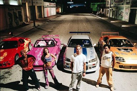 Michael Ealy Amaury Nolasco as Orange Julius, Devon Aoki as Suki, Paul Walker as Brian O'Conner and  as Slapjack in Universal's 2 Fast 2 Furious - 2003