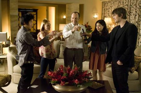 Kevin Spacey In Columbia Pictures' 21, the M.I.T. blackjack team - a group of students that has figured out how to take Vegas for millions - toasts its success.  Left to right: Choi (Aaron Yoo), Jill Taylor (Kate Bosworth), Micky Rosa (), Kianna (Liz