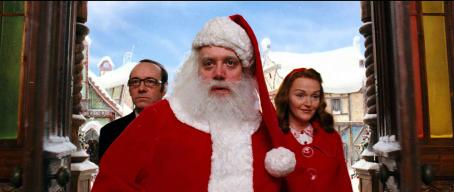 "Paul Giamatti (L-r) KEVIN SPACEY as Clyde, PAUL GIAMATTI as Santa Claus and MIRANDA RICHARDSON as Annette Claus in Warner Bros. Pictures' comedy ""Fred Claus."" Photo courtesy of Warner Bros. Pictures"