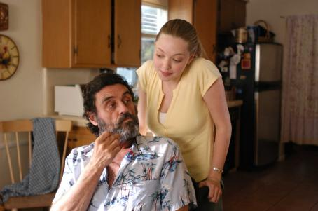 Nine Lives Ian McShane as Larry and Amanda Seyfried as Samantha in NINE LIVES, a film by Rodrigo Garcia, a Magnolia Pictures Release.