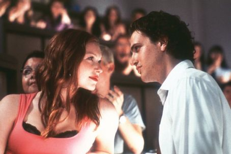 Slackers Angela's seductive roommate Reanna (Laura Prepon) gives Sam (Jason Segel) a run for his money in Screen Gems'  - 2002