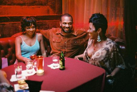 Sommore Wendy Raquel Robinson (left), Mike Epps (center) and  (right) star in Sanaa Hamri's SOMETHING NEW, a Focus Features release. Photo by Sidney Baldwin.