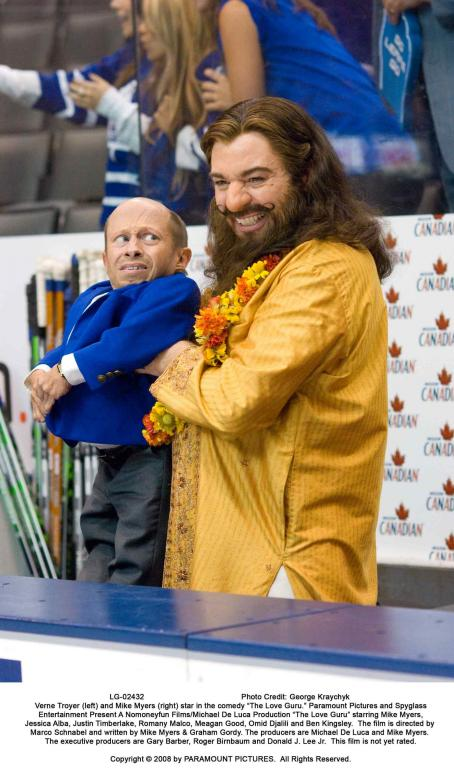"Verne Troyer  (left) and Mike Myers (right) star in the comedy ""The Love Guru."" Photo Credit: George Kraychyk. Copyright © 2008 by PARAMOUNT PICTURES. All Rights Reserved"
