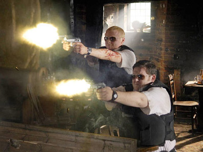 Hot Fuzz Simon Pegg as Nicholas Angel with his partner Nick Frost as Danny Butterman in action comedy '' 2007