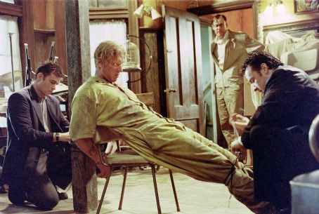 Jake Busey Rhodes (Ray Liotta), who ties up his prisoner Robert Maine () with the help of George York (John C. McGinley) and Ed (John Cusack) during a stormy night at a roadside motel.