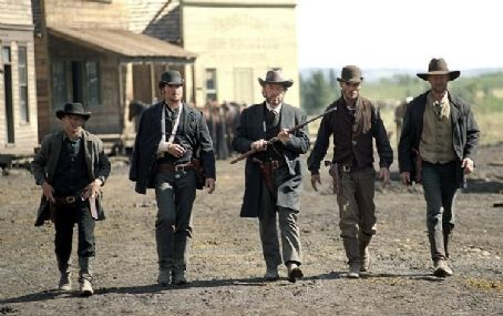 Open Range Evil rancher Denton Baxter (Michael Gambon, center), flanked by his henchmen, arrives at Harmonville's Main Street for a decisive gun battle.