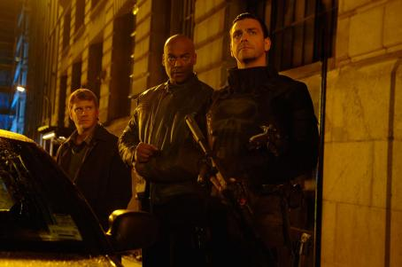 Dash Mihok Det. Martin Soap (), Paul Budiansky (Colin Salmon) and 'The Punisher' Frank Castle (Ray Stevenson) in PUNISHER: WAR ZONE. Photo credit: Jonathan Wenk