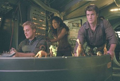Nathan Fillion Wash (Alan Tudyk), Zoe (Gina Torres) and Captain Mal Reynolds ().
