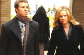 JR Bourne  as Ray and Laura Linney as Erin Bruner in Scott Derrickson's THE EXORCISM OF EMILY ROSE, Screen Gems release. © 2005