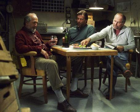 "John Kapelos Guys in back eating: Richard Libertini as ""Papa"" Tempesti, John Enos III as Gianluca and  as Steve in EVERYBODY WANTS TO BE ITALIAN, directed by Jason Todd Ipson. Courtesy of Roadside Attractions"