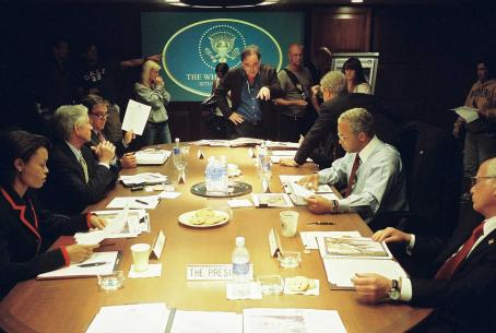 Scott Glenn Director Oliver Stone (standing, center) on the set of his film W., with (left to right, seated) Condi Rice (Thandie Newton), Donald Rumsfeld (), George Tenet (Bruce McGill), George W. Bush (Josh Brolin, seated on table), Colin Powell (Jeffrey