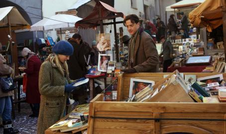 Eliza Bennett (L-R) Meggie (ELIZA HOPE BENNETT) and Mo (BRENDAN FRASER) peruse vintage novels at a book market in New Line Cinema's fantasy adventure 'Inkheart,' also starring PAUL BETTANY, HELEN MIRREN, JIM BROADBENT and ANDY SERKIS. This film is distribut