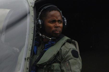 Harold Perrineau Flynn () peers out the side of his helicopter.