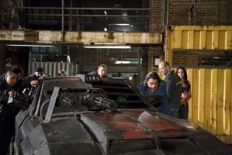 Natalie Martinez Jacob Vargas, Ian McShane, Jason Statham and  in the scene of Death Race.