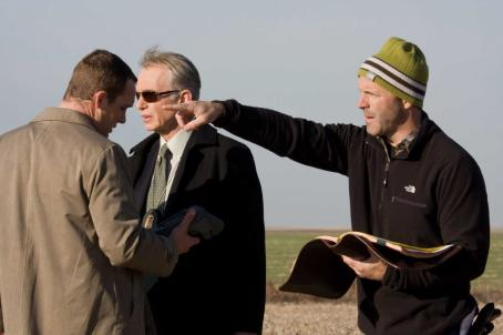 "D.J. Caruso (Left to right) Actors Ethan Embry (Agent Toby Grant) and Billy Bob Thornton (Agent Morgan) with director  on the set of the race-against-time thriller ""Eagle Eye."" Photo Credit: Ralph Nelson. Copyright © 2008 by DREAMWORKS LLC. All"
