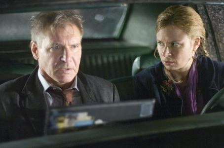 "Mary Lynn Rajskub Harrison Ford as Jack Stanfield and  as Janet Stone in Warner Bros. Pictures' and Village Roadshow Pictures' action thriller ""Firewall."" The film also stars Paul Bettany. Photo by Diyah Pera"