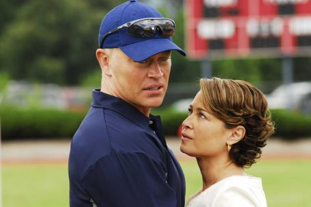 Neal McDonough Natalie (Julie Warner) comforts Coach Penning ()