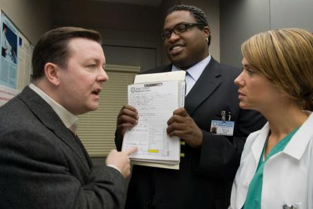 "Kristen Wiig Bertram Pincus (Ricky Gervais, left) is disturbed by a revelation from his surgeon (, right) and a hospital lawyer (Michael-Leon Wooley, center) in the comedy ""Ghost Town."" Photo Credit: Sarah Shatz. Copyright © 2008 DREAMWORKS LLC"