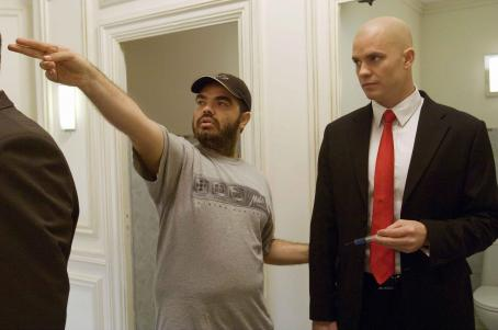 Director Xavier Gens makes a point to Timothy Olyphant on the set of HITMAN. Photo credit: Eric Caro.