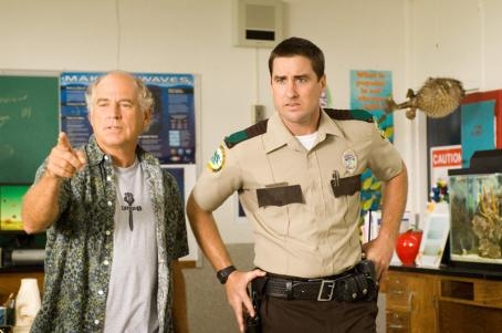 "Jimmy Buffett  as ""Mr. Ryan"" and Luke Wilson as 'Officer Delinko'"