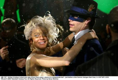 Ashley Albright Ashley (Lindsay Lohan) and Jake (Chris Pine) enjoy a dance at a masquerade ball - just before a kiss forever changes their lives, in JUST MY LUCK. TM and © 2006 Twentieth Century Fox. All Right Reserved. Photo by Barry Wecher.