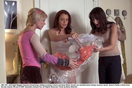 Ashley Albright (left-right) Maggie (Samaire Armstrong), Ashley (Lindsay Lohan) and Dana (Bree Turner) are shocked when Ashley receives Sarah Jessica Parker's dress from the dry cleaner. TM and © 2006 Twentieth Century Fox. All Right Reserved. Photo by Barry Wecher.