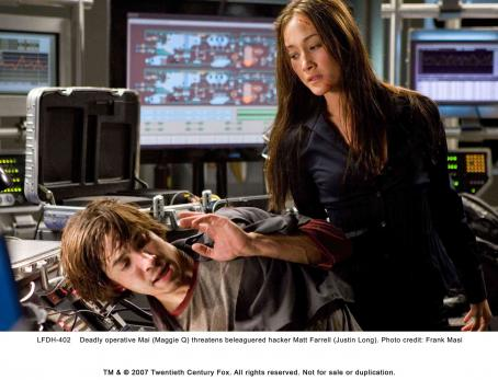 Live Free or Die Hard Deadly operative Mai (Maggie Q) threatens beleaguered hacker Matt Farrell (Justin Long). Photo credit: Frank Masi