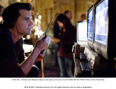 Live Free or Die Hard Director Len Wiseman takes in the action on the set of LIVE FREE OR DIE HARD. Photo credit: Frank Masi