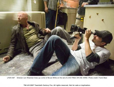 Live Free or Die Hard Director Len Wiseman lines up a shot of Bruce Willis on the set of LIVE FREE OR DIE HARD. Photo credit: Frank Masi