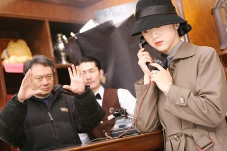Lust, Caution Director Ang Lee (left) and Tang Wei (right) on the set of LUST, CAUTION, a Focus Features release.