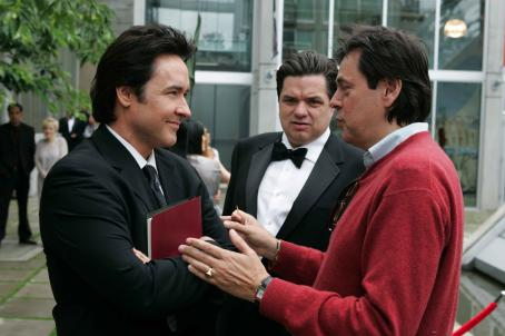 Oliver Platt John Cusack (left) and  (center) discuss a scene with Director Menno Meyjes (right) on the set of New Line Cinema's release of MARTIAN CHILD. Photo Credit: Alan Markfield/New Line Cinema