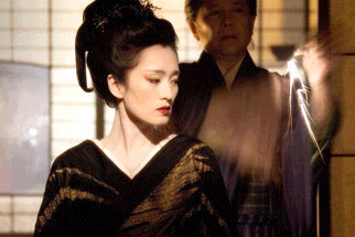 Gong Li as Hatsumomo and Kenneth Tsang as General in Rob Marshall's Memoirs of a Geisha, also starring Ken Watanabe and Zhang Ziyi.
