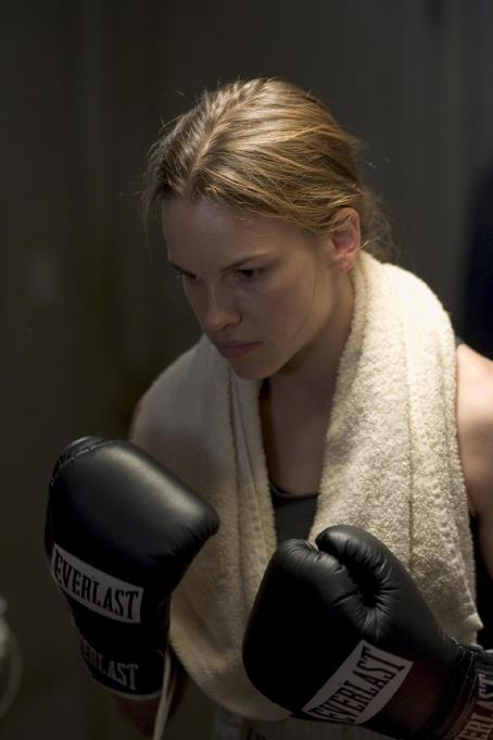 Maggie Fitzgerald Hilary Swank as Maggie in Warner Bros. Pictures' drama Million Dollar Baby. The Malpaso production also stars Clint Eastwood and Morgan Freeman. Merie W. Wallace