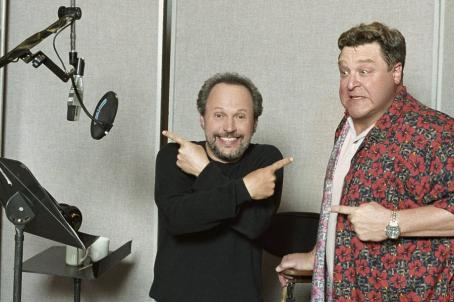 Monsters, Inc. Billy Crystal (left), who gave voice to Mike Wazowski, clowns around off-mic with John Goodman (right), who helped bring Sulley to life in Disney's  - 2001