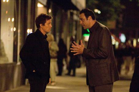 "Brad Garrett HUGH GRANT as Alex Fletcher and BRAD GARRETT as Chris Riley in Warner Bros. Pictures' and Village Roadshow Pictures' romantic comedy ""Music and Lyrics,"" distributed by Warner Bros. Pictures. The film also stars Drew Barrymore. Phot"