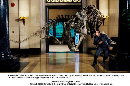 Night at the Museum Security guard Larry Daley (Ben Stiller) flees, as a Tyrannosaurus Rex that has come to life at night carves a swath of destruction through a museum's marble corridors. Photo credit: Rhythm & Hues
